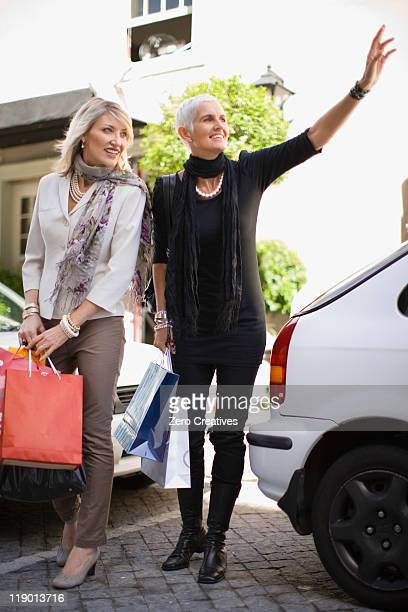 Older women carrying shopping bags