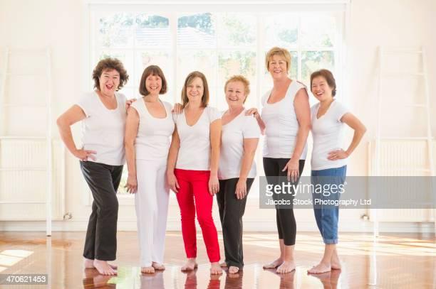 Older women smiling together indoors