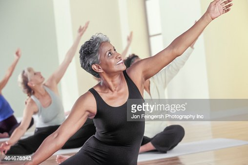 Older women stretching in yoga class