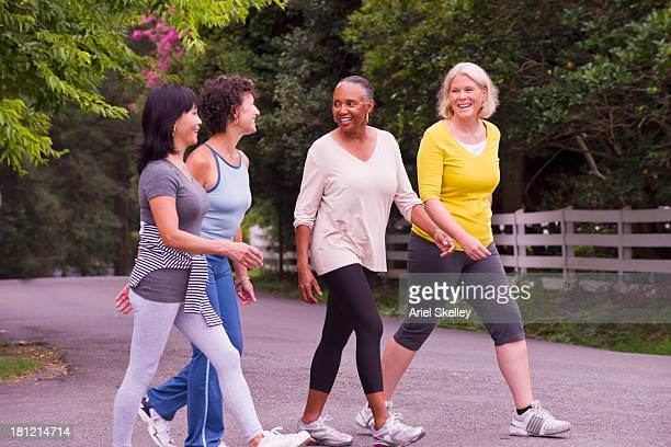 Older women walking together outdoors