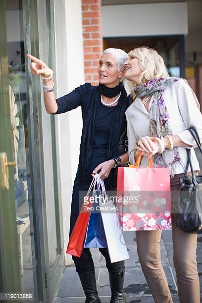 Older women window shopping together