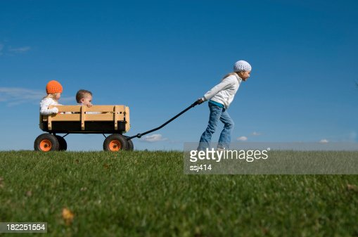 Oldest Girl Pulling Smallest Siblings in Wagon