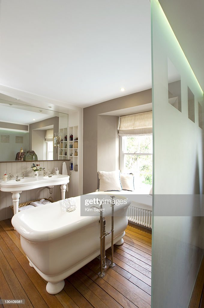 Old-fashioned bathtub in bathroom : Stock Photo