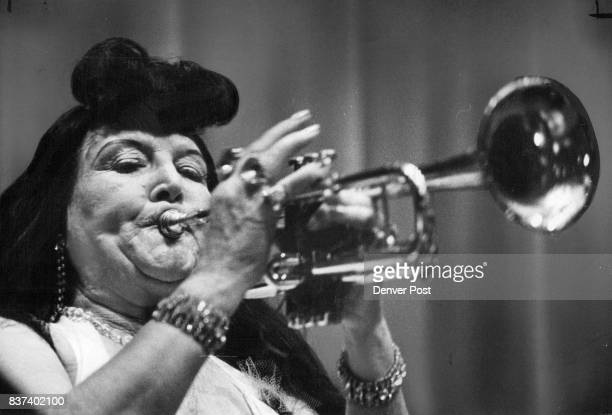 OldFashioned Good Time Ethelym Sturbibant plays the trumpet above as couples below dance to music of Minnie's Troubadours led by Mrs Minnie Walton at...