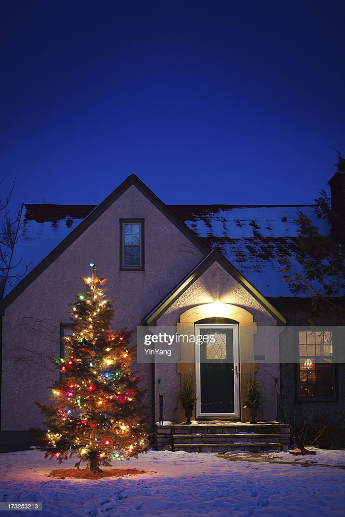 old fashioned house with decorated christmas tree lights in snowy yard stock photo - Old Fashioned Christmas Tree Lights