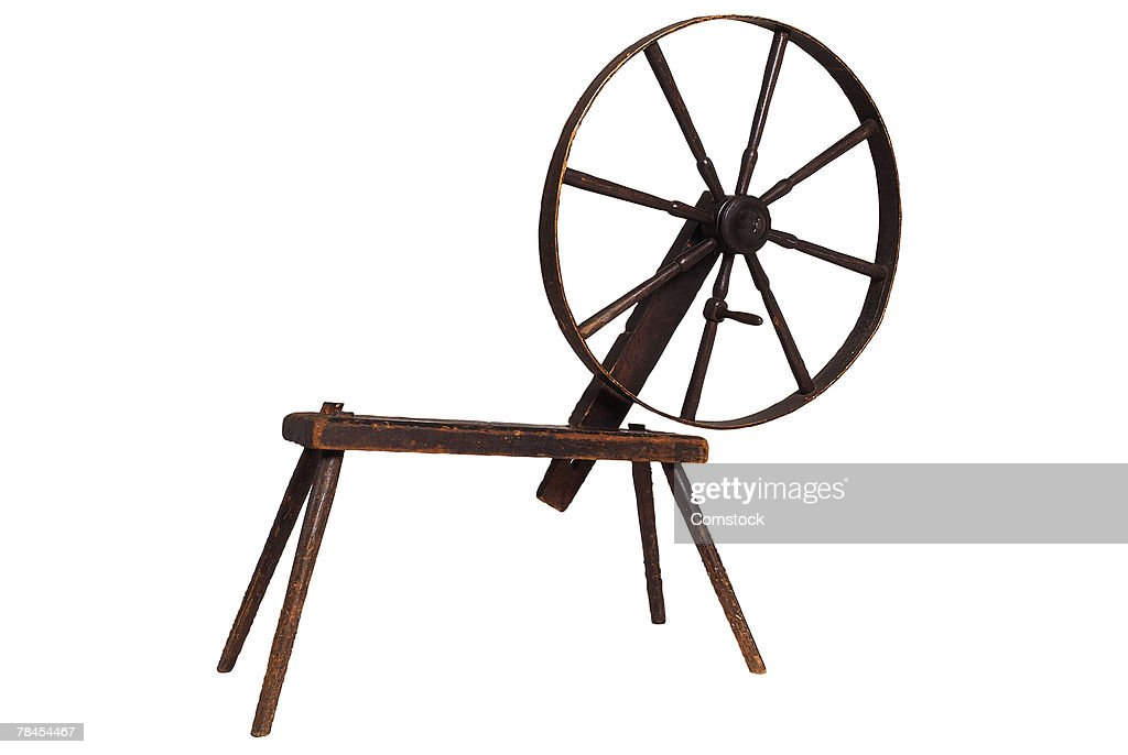 Old-fashioned spinning wheel : Stock Photo