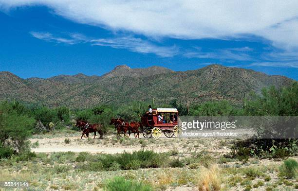Old-fashioned stagecoach pulled by horses, Old Tucson, Arizona, USA