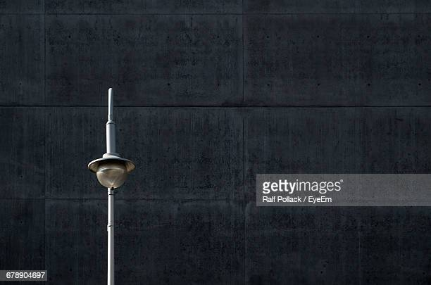 Old-fashioned Street Light Against Wall