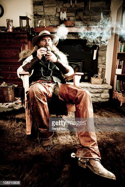 Old-Fashioned Western Cowboy Smoking a Pipe