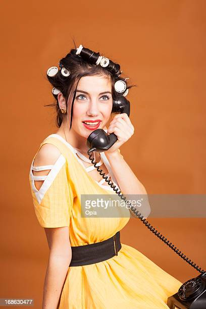 Old-fashioned woman on old telephone