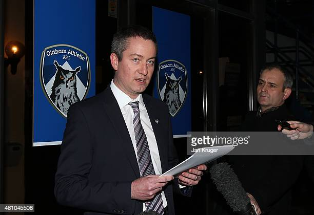 Oldham Athletic Chief Executive Neil Joy reads out a statement on behalf of the club at Boundary Park on January 5 2015 in Oldham England
