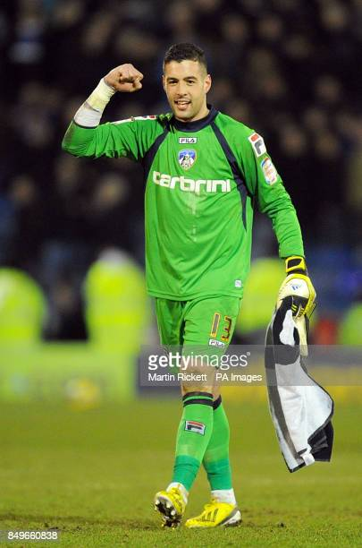 Oldham Athletic goalkeeper Dean Bouzanis celebrates after the final whistle