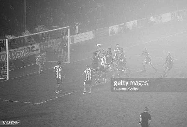 Oldham Athletic search for a late equaliser in the fog during the Emirates FA Cup Second Round match between Lincoln City and Oldham Athletic at...