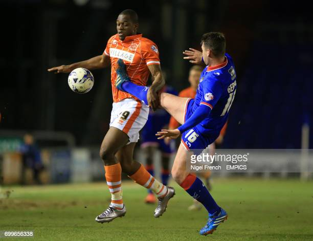 Oldham Athletic's Anthony Gerrard and Blackpool's Uche Ikpeazu battle for the ball
