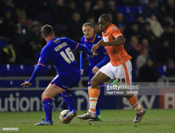 Oldham Athletic's Anthony Gerrard and Blackpool's Uche Ilpeazu battle for the ball
