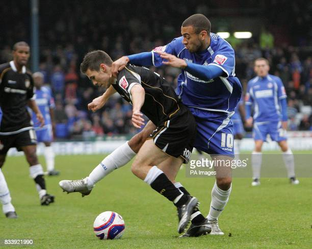 Oldham Athletic's Craig Davies and Port Vale's Jason Talbot during the CocaCola Football League One match at Boundary Park Oldham