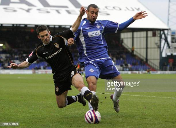Oldham Athletic's Craig Davies and Port Vale's Jason Talbot in action during the CocaCola Football League One match at Boundary Park Oldham