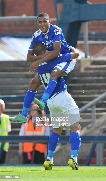 Oldham Athletic's Cristian Montano is congratulated by Jonson ClarkeHarris after scoring a goal