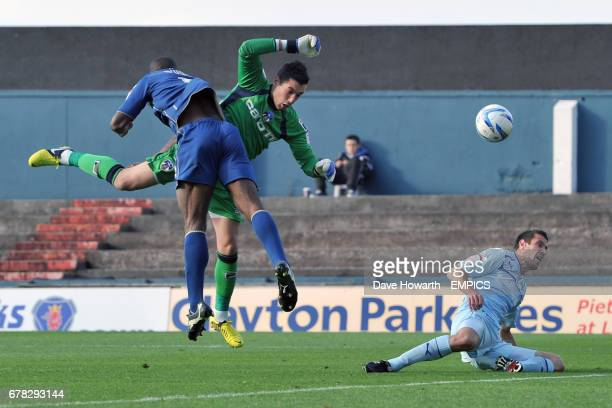 Oldham Athletic's goalkeeper Dean Bouzanis collides with teammate Jean Yves Mvoto Owono