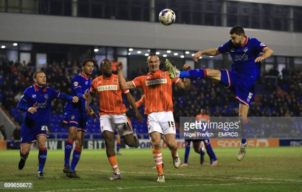 Oldham Athletic's James Wilson and Blackpool's Tom Aldred battle for the ball