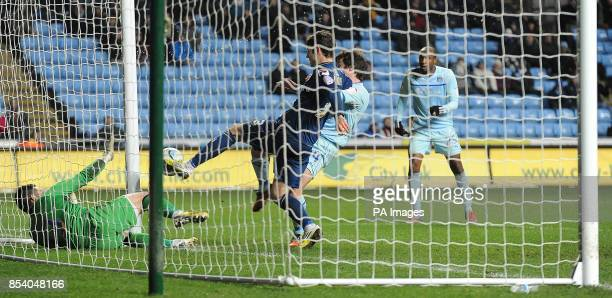 Oldham Athletic's Jonathan Grounds clears the ball off the line after Coventry City's Stephen Elliott's header is saved by goalkeeper Dean Bouzanis...