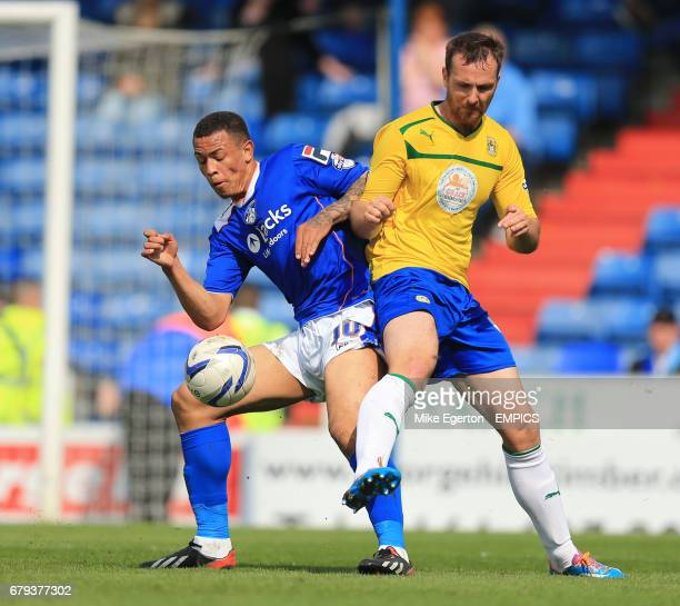 Oldham Athletic's Jonson ClarkeHarris and Coventry City's Andy Webster in action