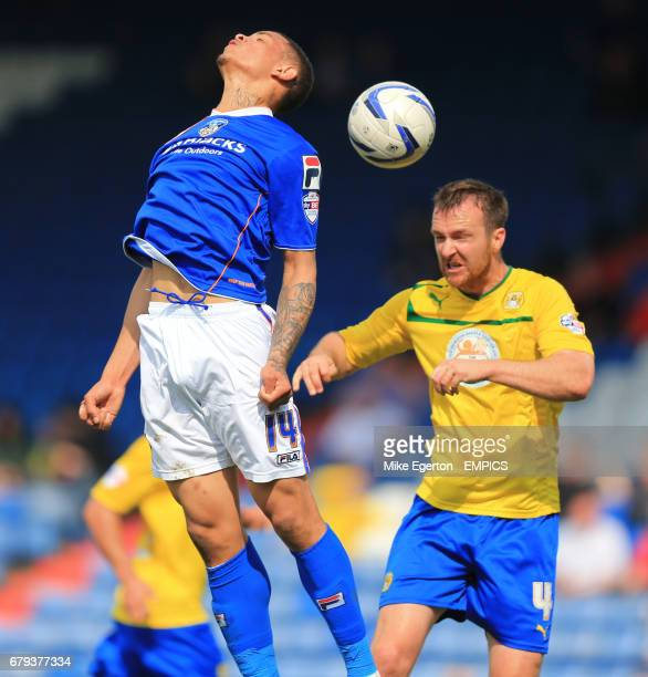 Oldham Athletic's Jonson ClarkeHarris and Coventry City's Andy Webster battle for the ball in the air
