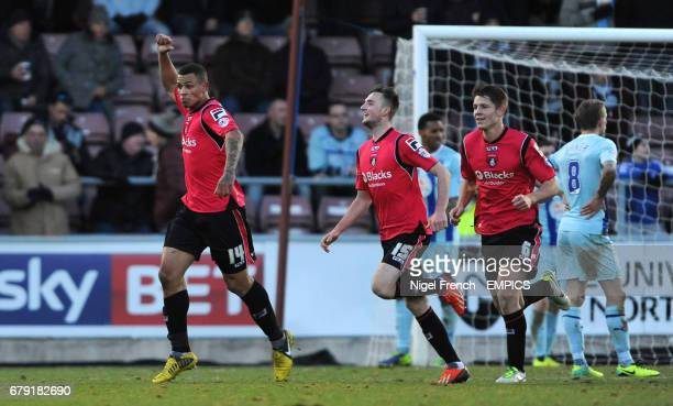 Oldham Athletic's Jonson ClarkeHarris celebrates with Carl Winchester and James Tarkowski after scoring the opening goal of the game against Coventry...