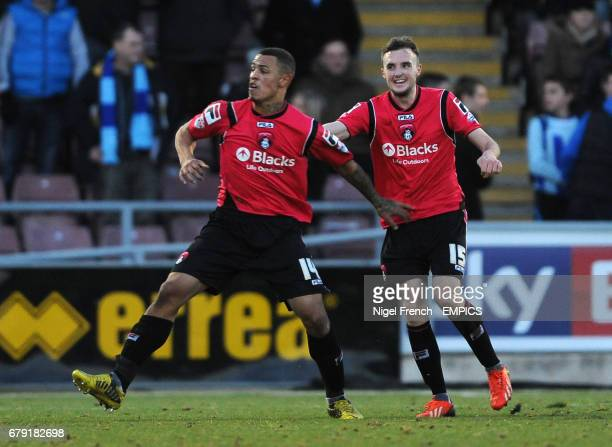 Oldham Athletic's Jonson ClarkeHarris celebrates with Carl Winchester after scoring the opening goal of the game against Coventry City