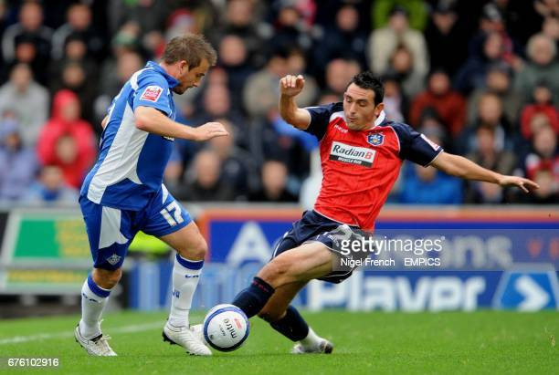 Oldham Athletic's Kiegan Parker and Huddersfield Town's Gary Roberts