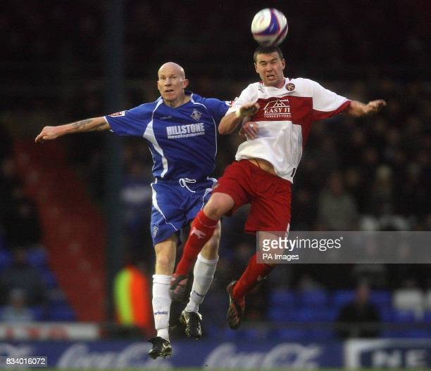 Oldham Athletic's Lee Hughes and Walsall's Anthony Gerrard during the CocaCola League One match at Boundary Park Oldham