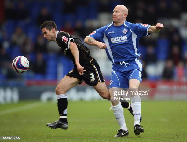 Oldham Athletic's Lee Hughes tussles with Port Vale's Jason Talbot during the CocaCola Football League One match at Boundary Park Oldham