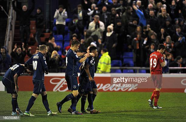 Oldham Athletic's Reece Wabara is congratulated by teammates after scoring the team's third goal during their 32 win in the English FA Cup fourth...