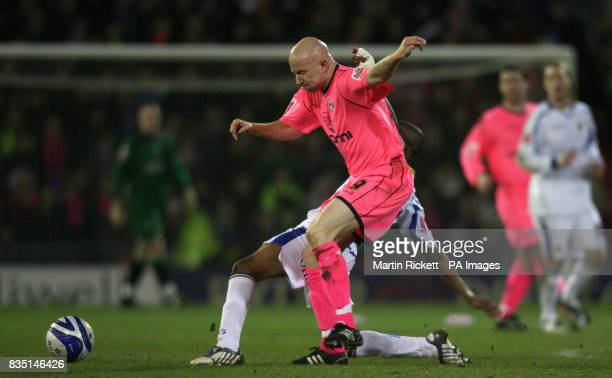 Oldham's Lee Hughes battles with Leed's Fabian Delph during the CocaCola League One match at Boundary Park Oldham