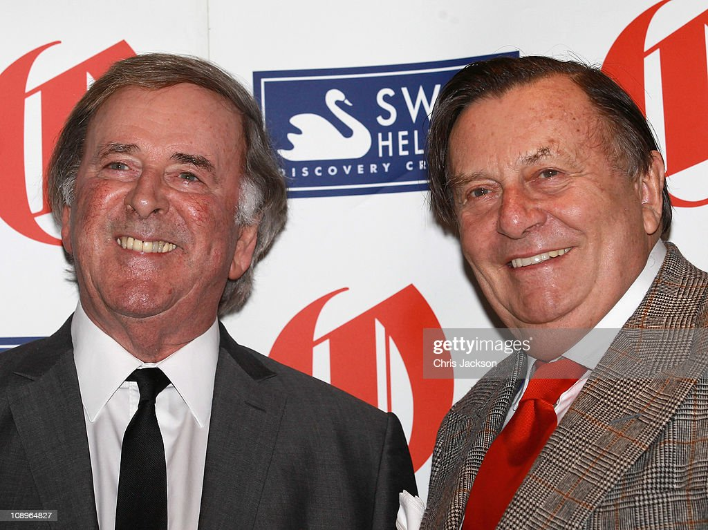 Oldie of the Year <a gi-track='captionPersonalityLinkClicked' href=/galleries/search?phrase=Barry+Humphries&family=editorial&specificpeople=206650 ng-click='$event.stopPropagation()'>Barry Humphries</a> and <a gi-track='captionPersonalityLinkClicked' href=/galleries/search?phrase=Terry+Wogan&family=editorial&specificpeople=234787 ng-click='$event.stopPropagation()'>Terry Wogan</a> pose for photographs as he attends the 'Oldie of the Year Awards 2011' at Simpsons on February 10, 2011 in London, England.