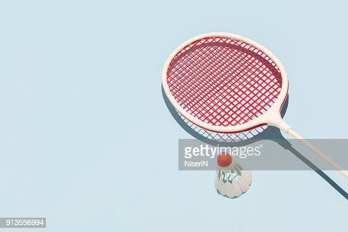 Oldschool racket and birdie on blue background : Stock Photo