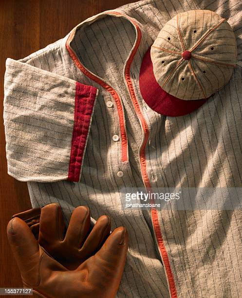 Old-time wool baseball uniform with cap and glove