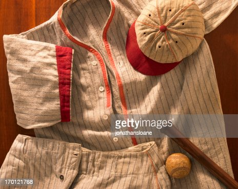 Old-time wool baseball uniform with cap, pants and bat