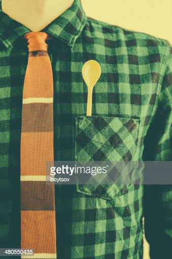 Oldtimed man with tie and yellow spoon in the pocket : Stock Photo