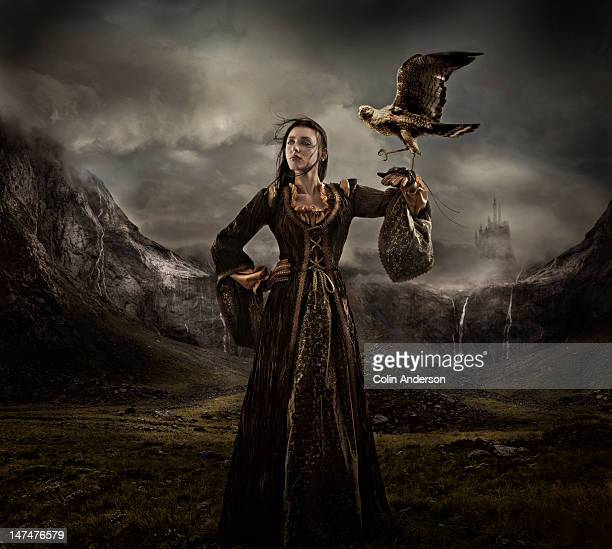 Old-world huntress holding a falcon