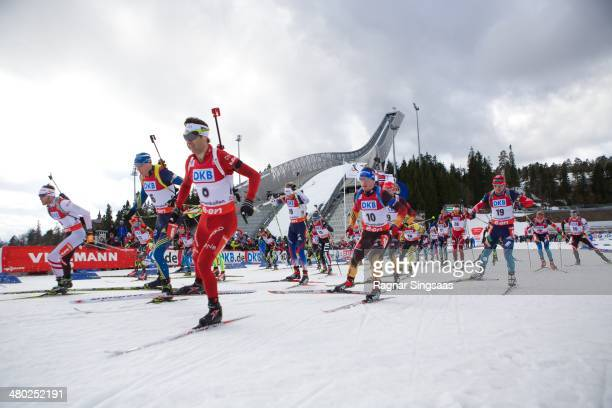 Ole Einar Bjoerndalen of Norway and Simon Schempp of Germany compete during the IBU Biathlon World Cup Men's 15 kilometer Mass Start race on March 23...