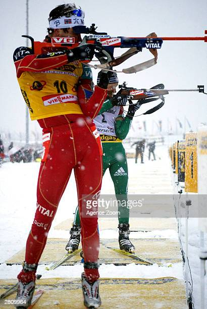 Ole Einar Bjoerndalen of Norway and Vladimir Dratchev of Belarus in action in the Mens Pursuit event at the Biathlon World Cup Event December 14 2003...
