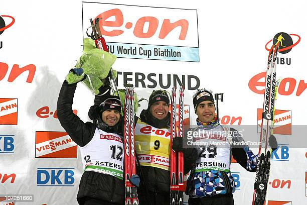 Ole Einar Bjoerndalen of Norway celebrates with Emil Hegle Svendsen of Norway and Martin Fourcade of France after the men's individual in the IBU...