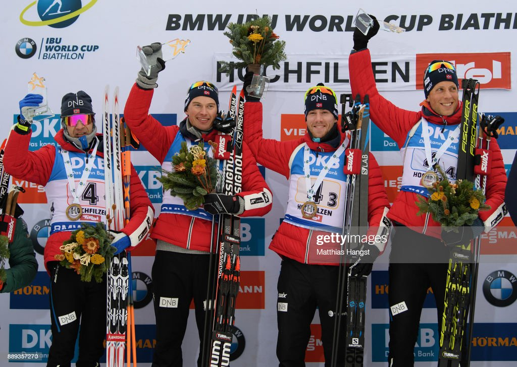 Ole Einar Bjoerndalen of Norway, Henrik L'Abee Lund of Norway, Erlend Bjoentegaard of Norway and Lars Helge Birkeland of Norway celebrate on the podium after the Men's 4x7.5km relay competition of the BMW IBU World Cup Biathlon on December 10, 2017 in Hochfilzen, Austria.