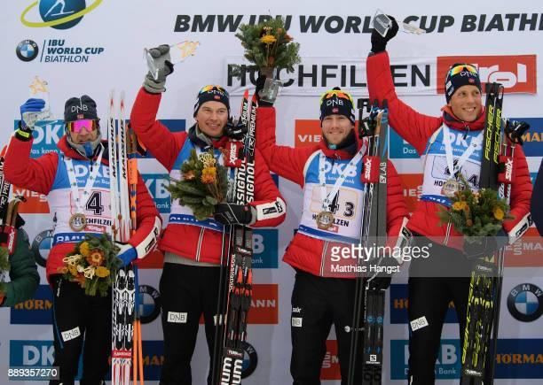 Ole Einar Bjoerndalen of Norway Henrik L'Abee Lund of Norway Erlend Bjoentegaard of Norway and Lars Helge Birkeland of Norway celebrate on the podium...