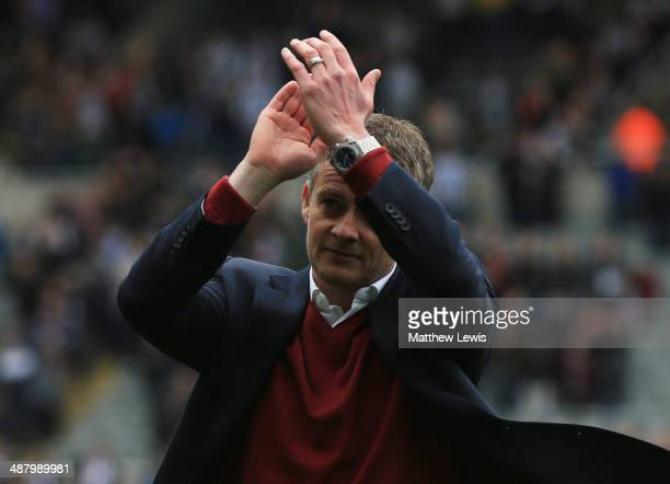 Ole Gunnar Solskjaer manager of Cardiff City applauds the travelling fans as they are relegated afterBarclays Premier League match between Newcastle...