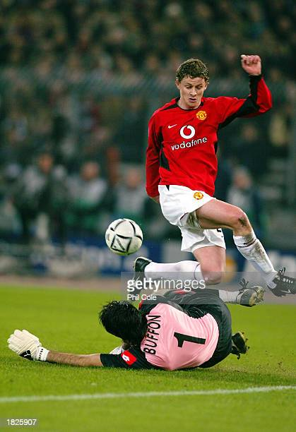Ole Gunnar Solskjaer of Manchester United is quickly closed down by Gianluigi Buffon of Juventus during the UEFA Champions League Second Phase Group...