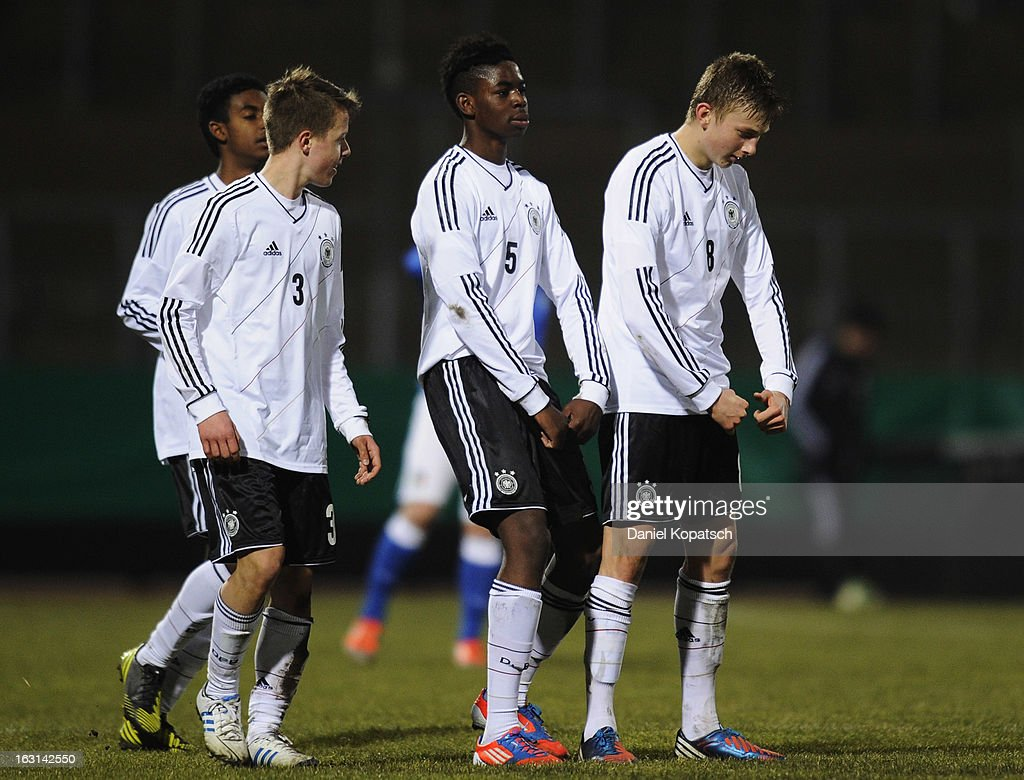 Ole Kaeuper of Germany (R) celebrates his team's fourth goal with team mates David Kammerbauer (L-R) and Jordan Torunarigha during the U16 international friendly match between Germany and Italy on March 5, 2013 at Waldstadion in Homburg, Germany.
