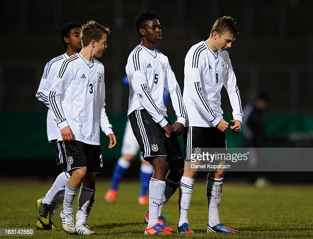 Ole Kaeuper of Germany celebrates his team's fourth goal with team mates David Kammerbauer and Jordan Torunarigha during the U16 international...
