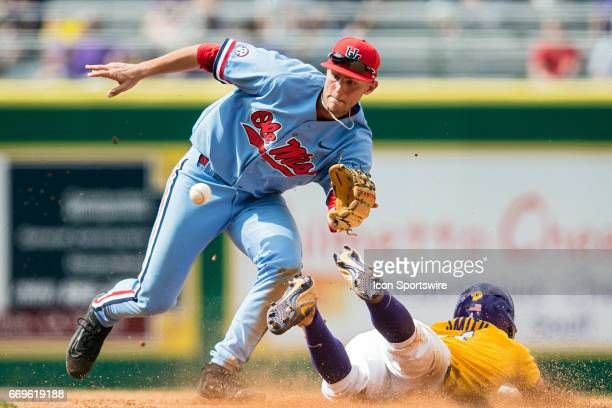 Ole Miss Black Bears infielder is unable to apply a tag to LSU Tigers infielder Josh Smith during a game between the LSU Tigers and Ole Miss Black...